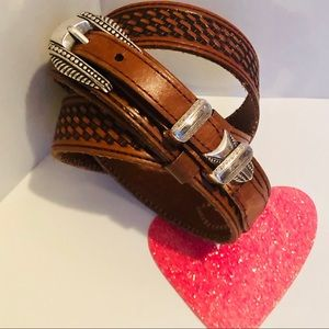 Leather brown belt with silver hardware.